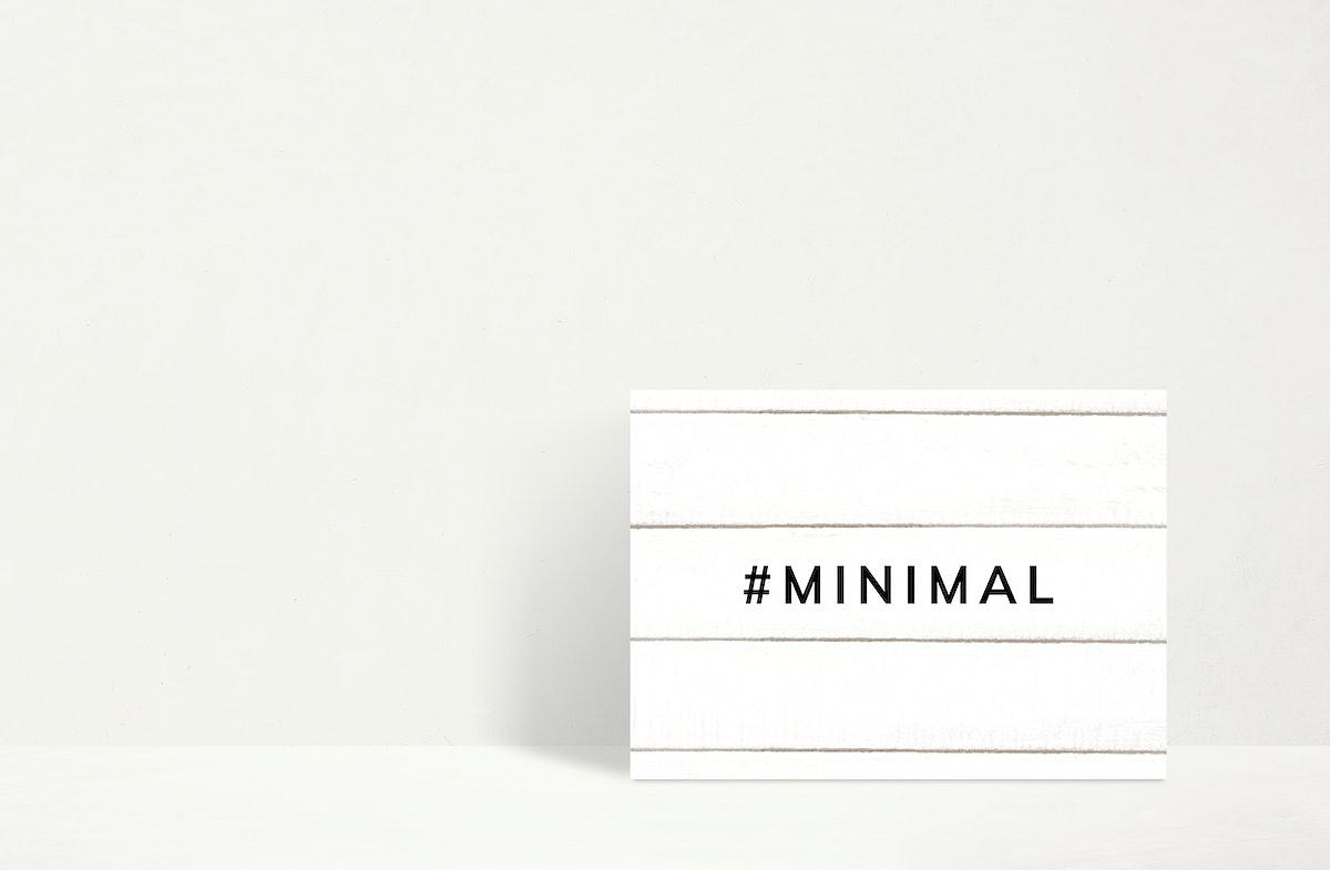 Minimal white frame mockup against a wall