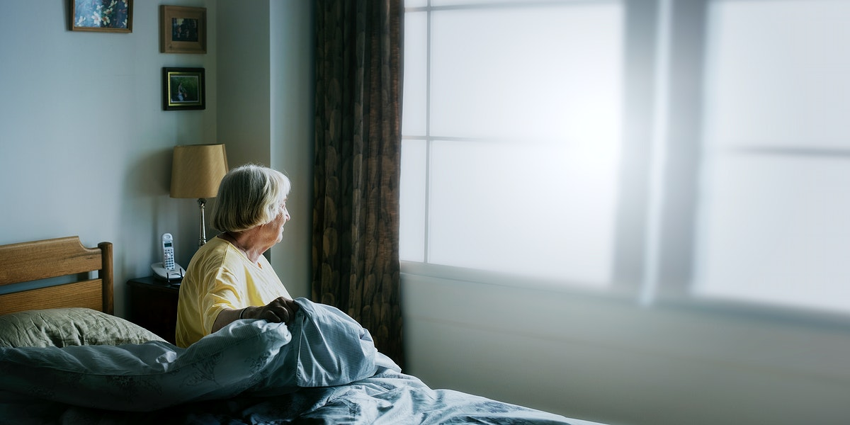 Senior woman having a self-isolation in a bedroom