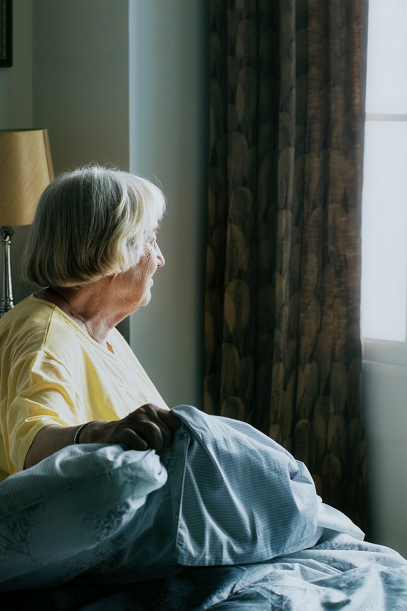 Elderly woman alone at home during social isolation due to Covid-19 pandemic