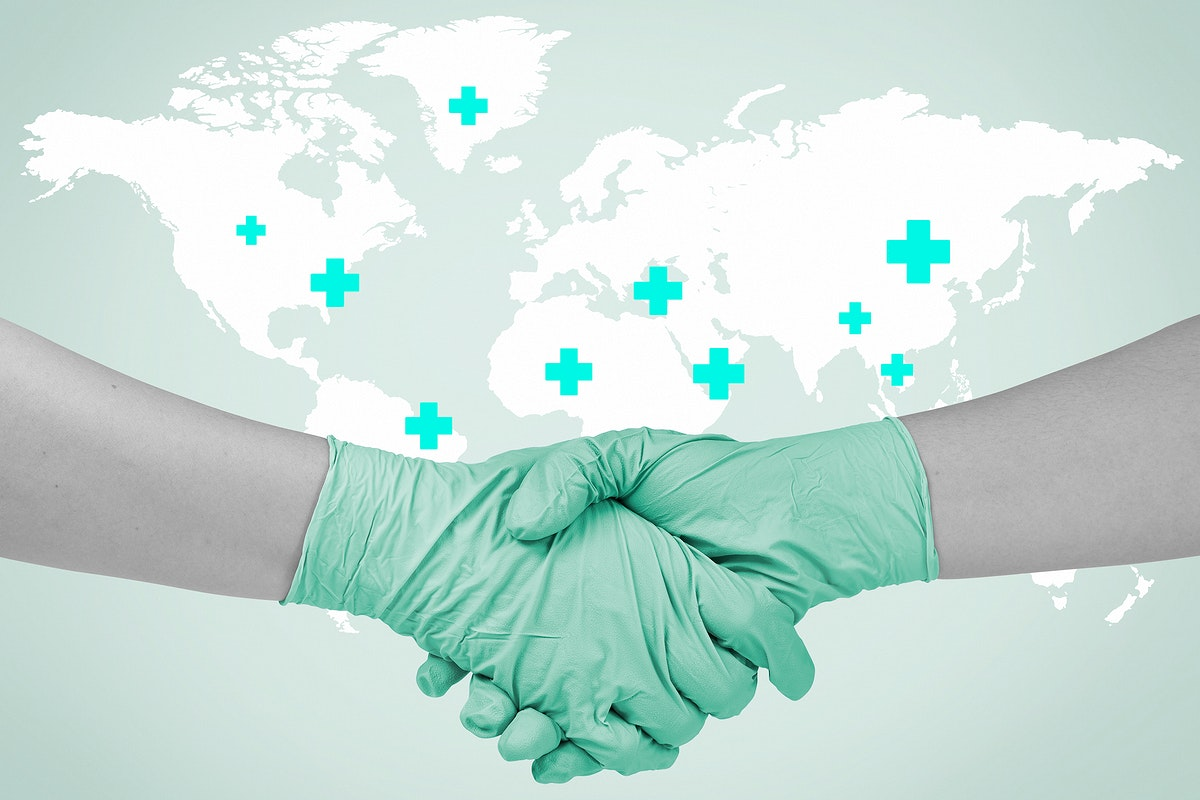 Gloved hands shaking hands to prevent coronavirus contamination