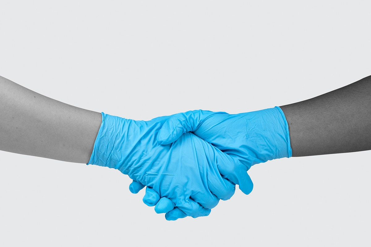 Shaking hands with latex gloves on to prevent coronavirus contamination
