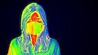 Woman wearing a face mask during coronavirus pandemic thermal image