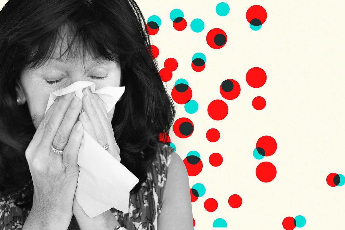 Sick woman sneezing and spreading the virus