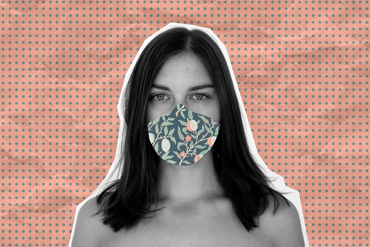 Woman wearing a floral face mask during coronavirus pandemic background