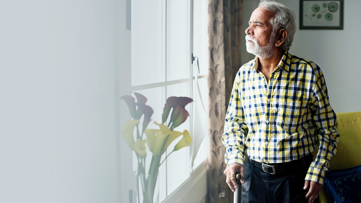 Elderly Indian man in self-isolation at home