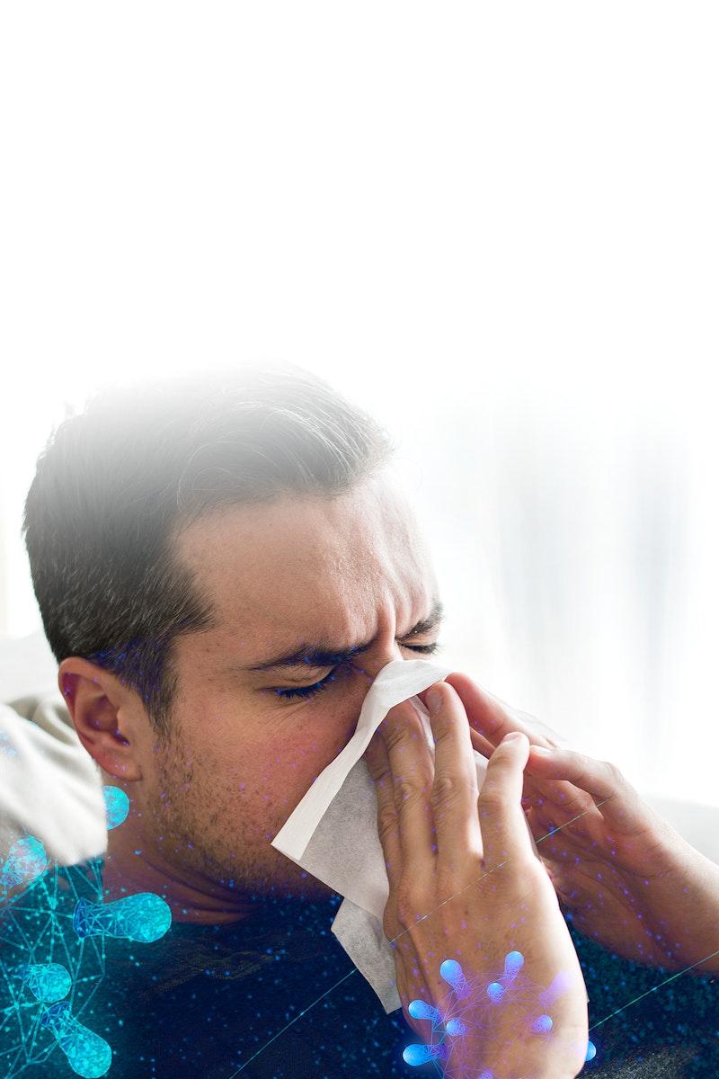 Man sneezing and showing coronavirus symptoms