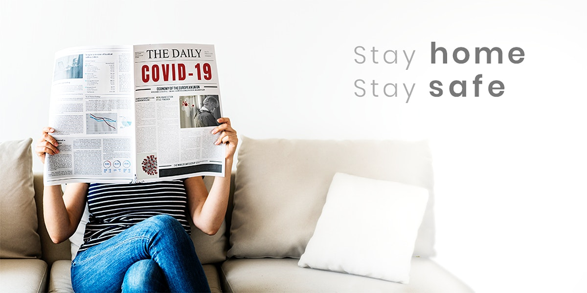 Woman reading coronavirus news from a newspaper during coronavirus quarantine