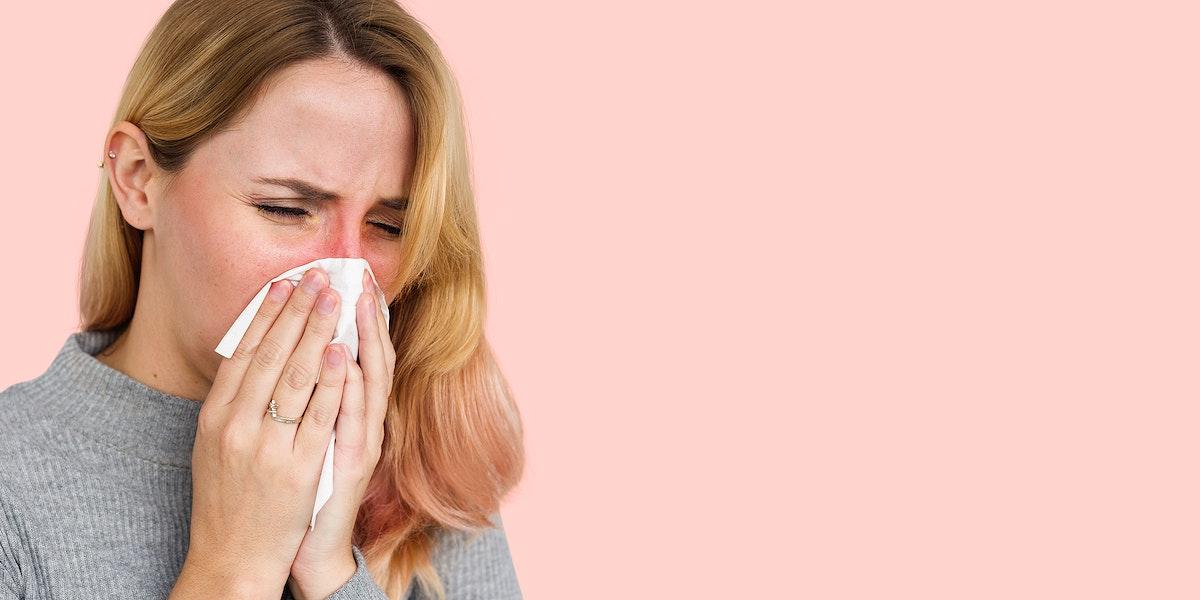 Sneezing woman with coronavirus symptoms