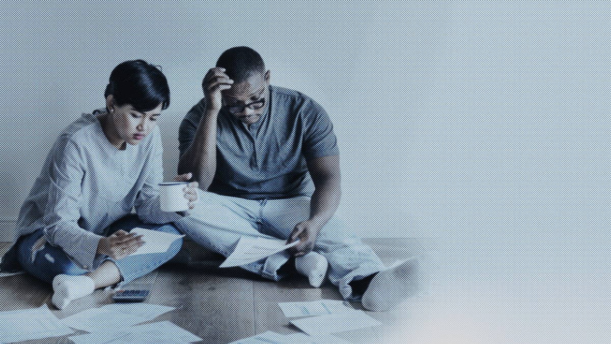 Couple managing their debt due to COVID-19
