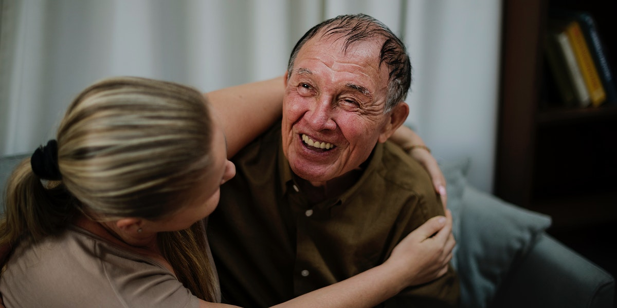 Daughter taking care of her elderly father