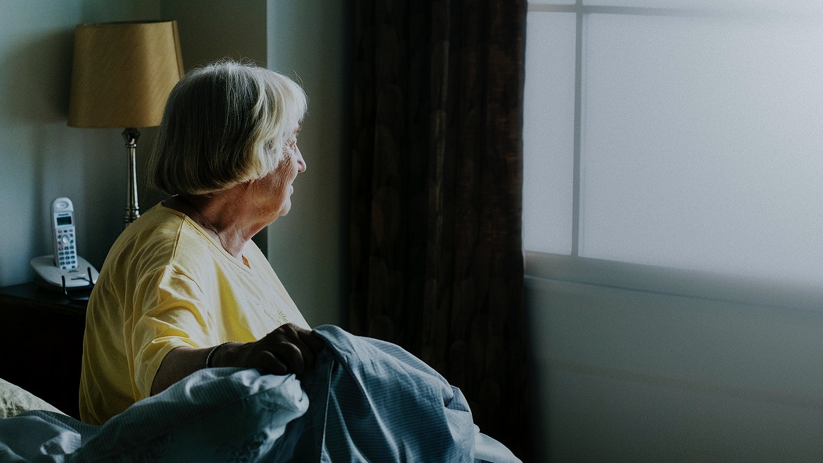 Elderly woman alone at home during social isolation