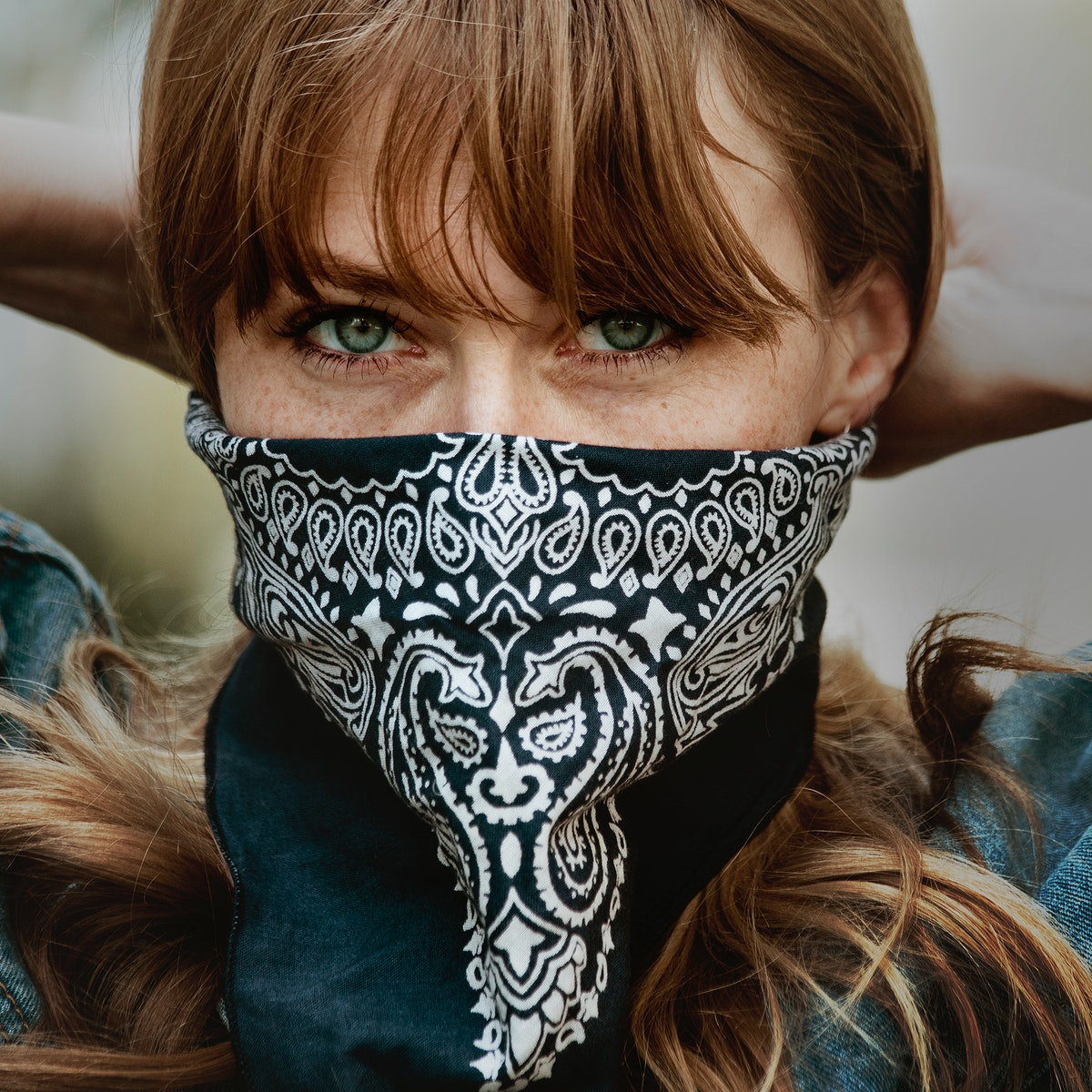 Woman covering her mouth and nose with a bandana during the coronavirus outbreak
