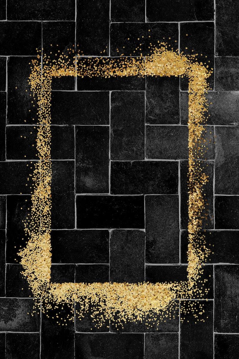 Glittery rectangle frame on a black brick patterned background