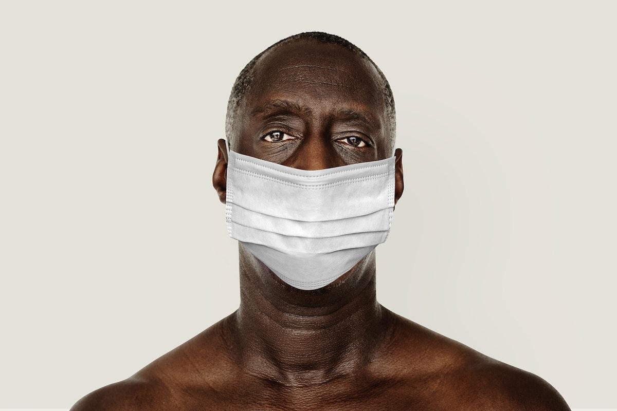 Black man wearing a face mask during coronavirus pandemic mockup