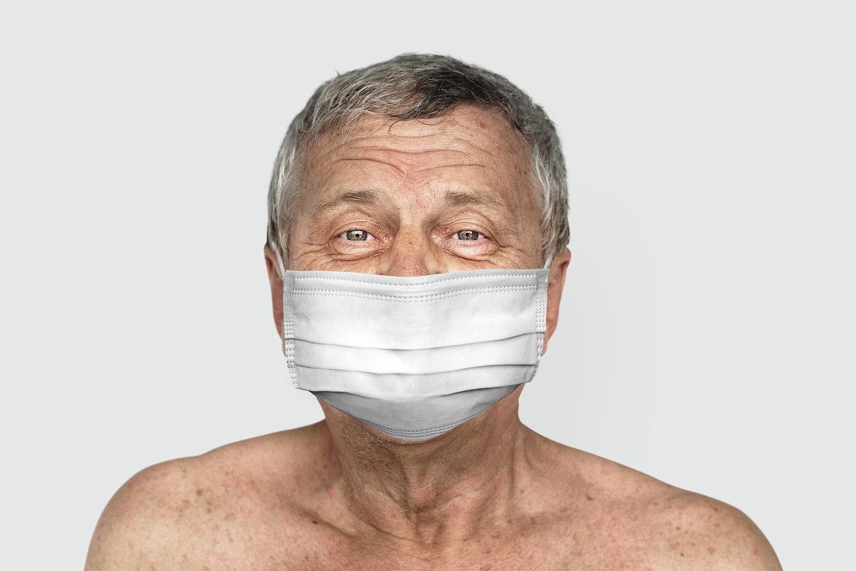 Old man wearing a face mask during coronavirus pandemic mockup