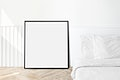 Picture frame mockup in a bedroom