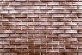 Copper painted brick wall textured background