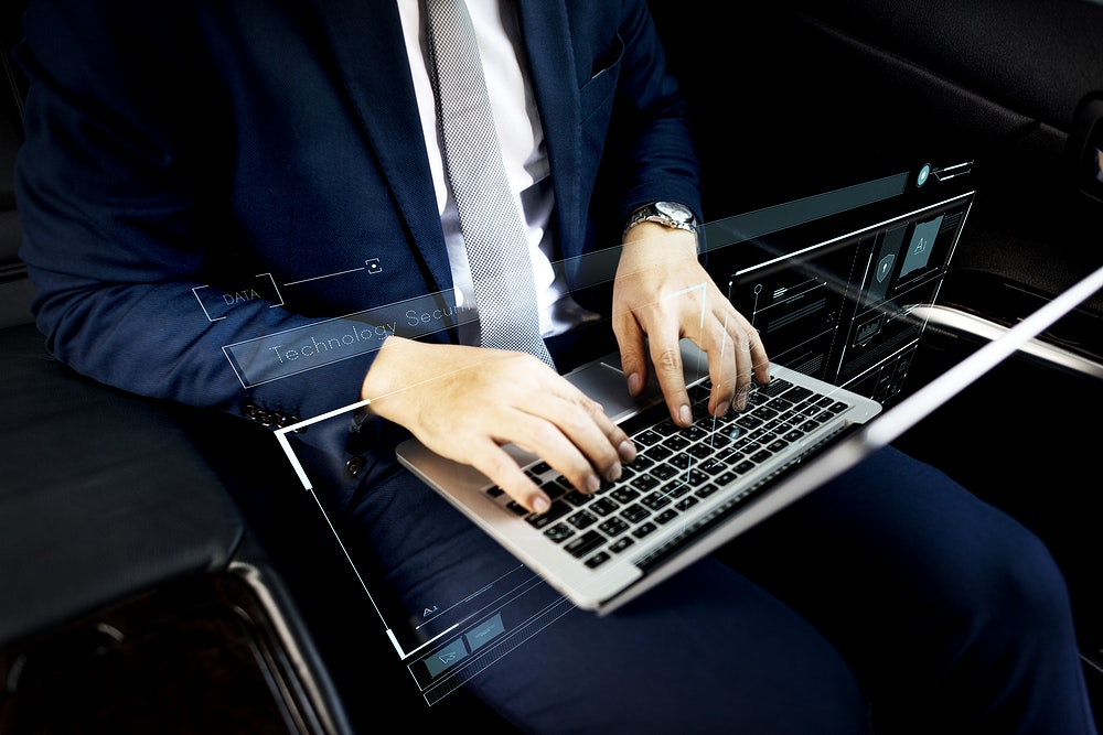 How to Succeed as a Programmer Businessman using his laptop in a car