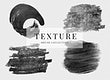 Black oil paint brush stroke textures set on a plain gray background