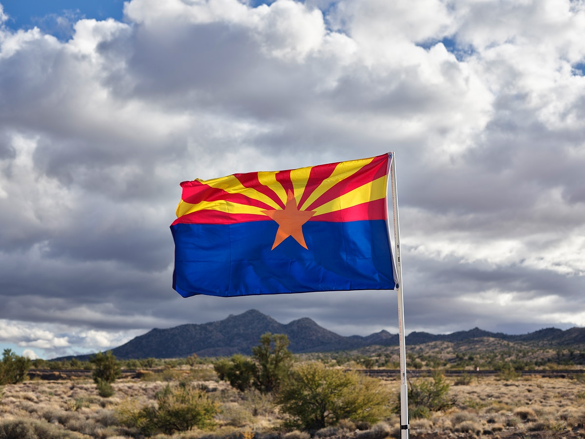 The Arizona state flag flies along old U.S. highway 66 in Mohave County, Arizona.
