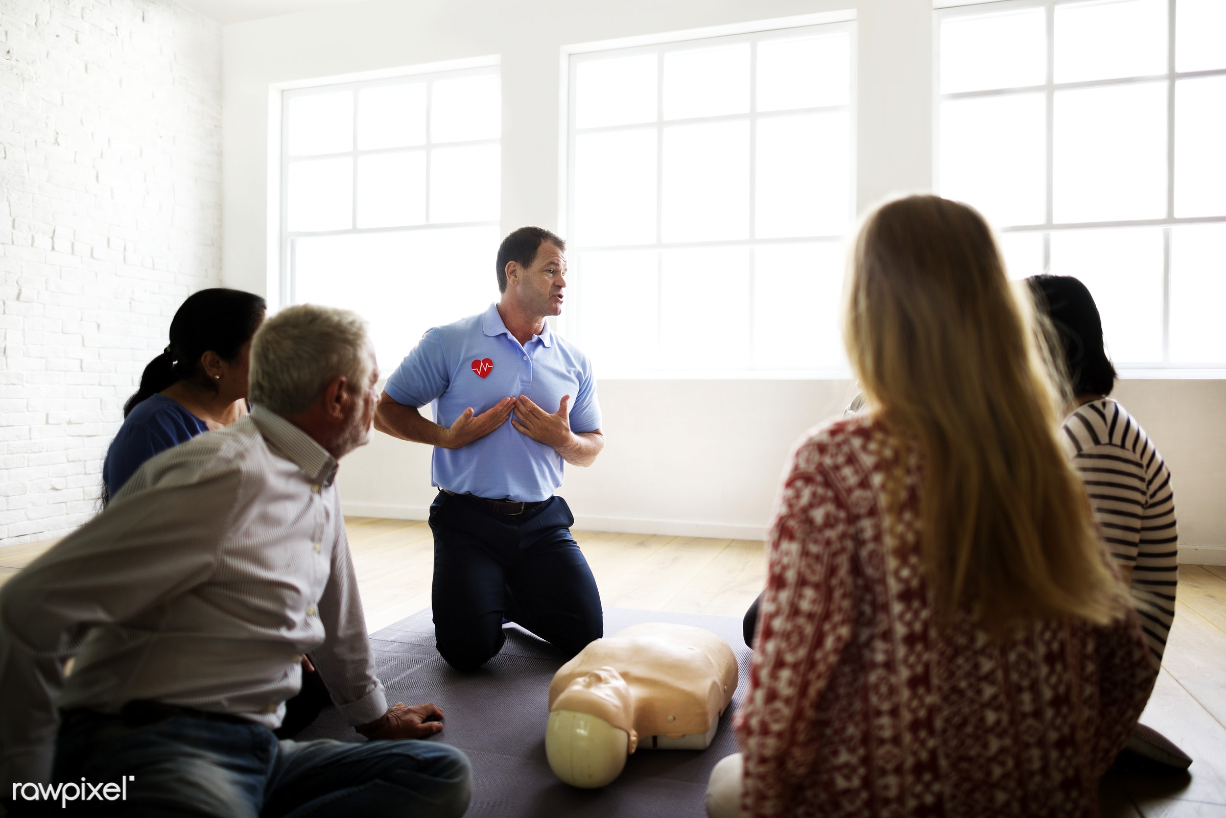 Diverse people taking a CPR first aid training class - cpr training, person, knowledge, save, first aid, treatment,...