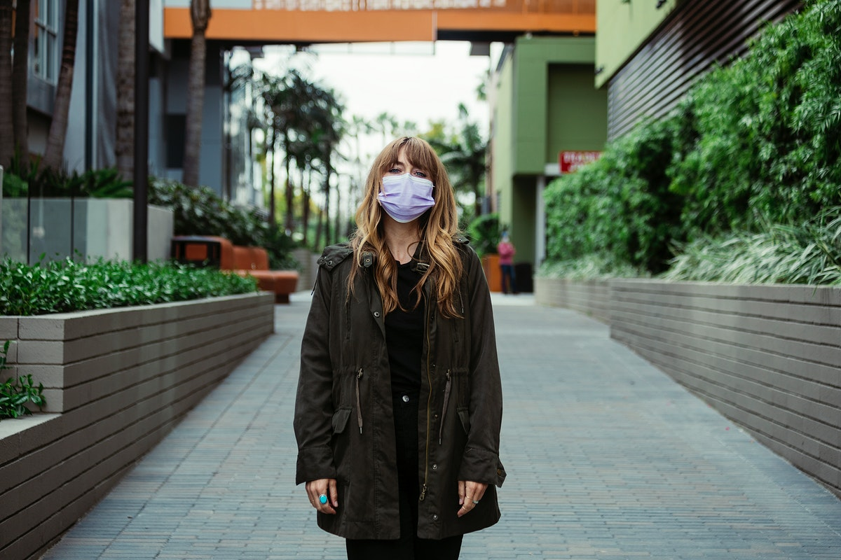 Woman with a face mask in public during coronavirus outbreak