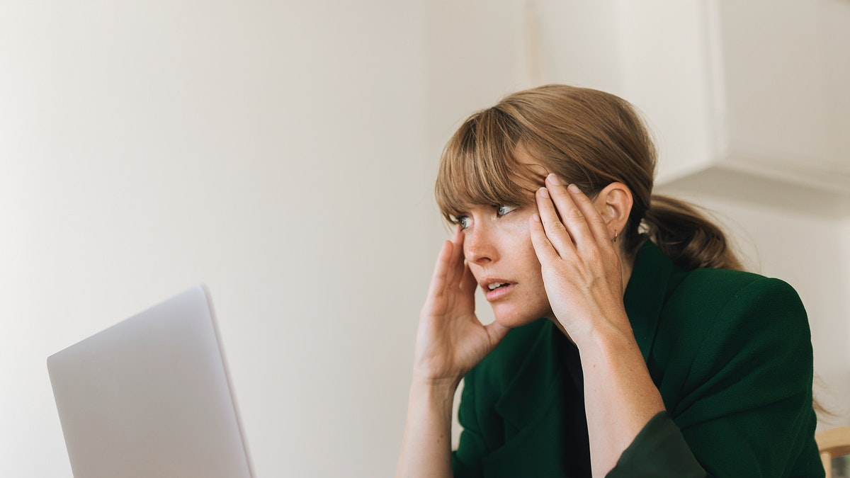 Stressed woman working from home during coronavirus quarantine