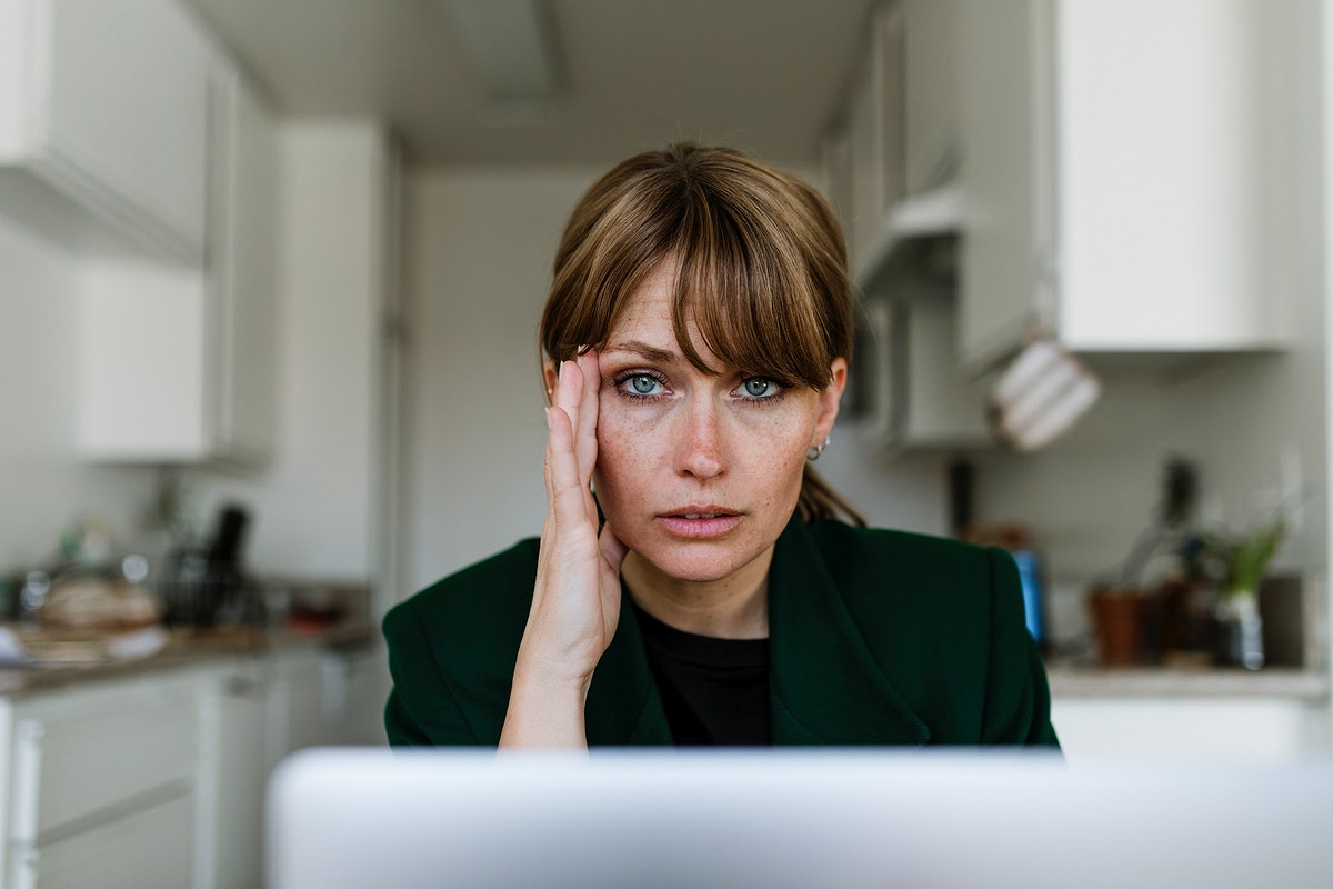 Stressed out woman working at home during coronavirus pandemic