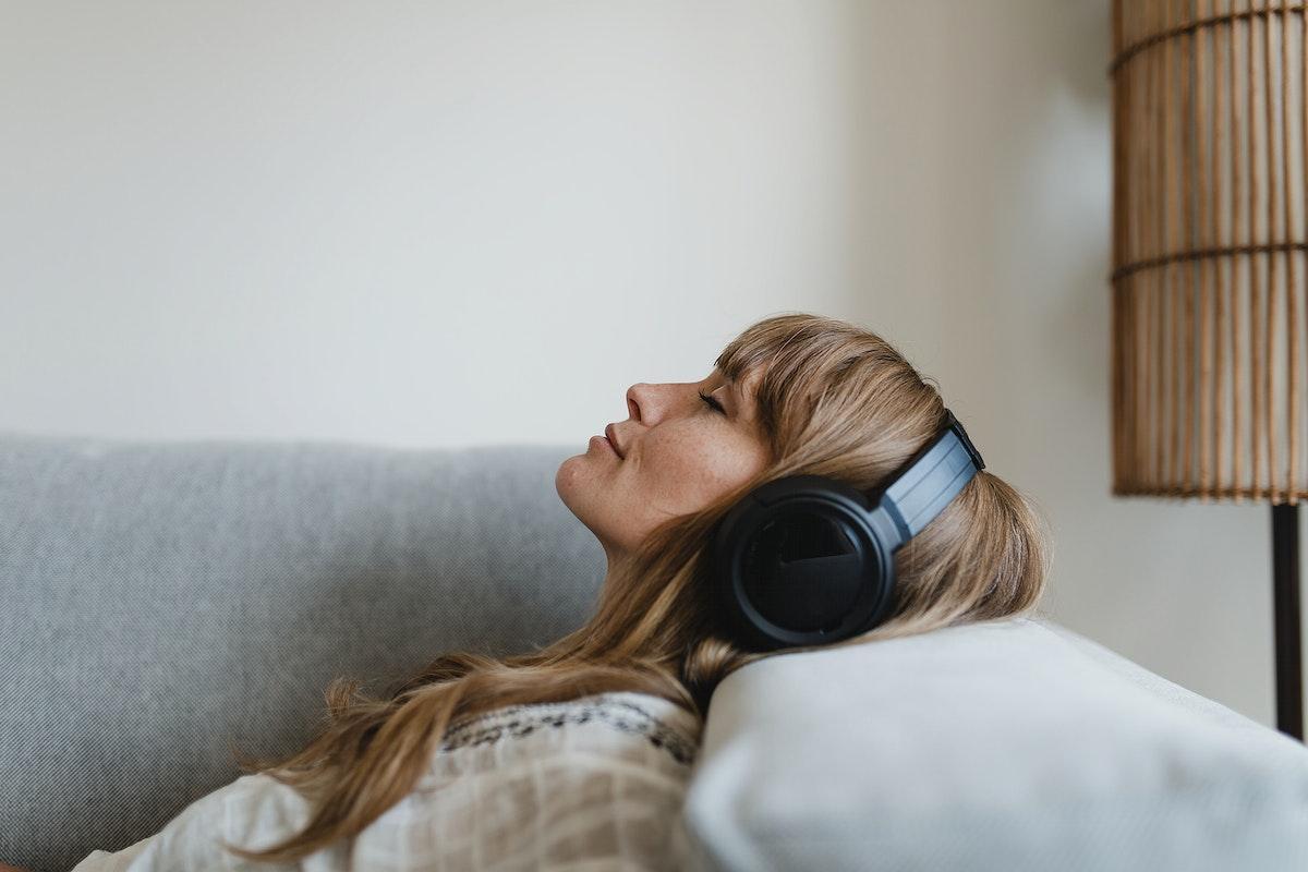 Woman listening to music at home during coronavirus pandemic