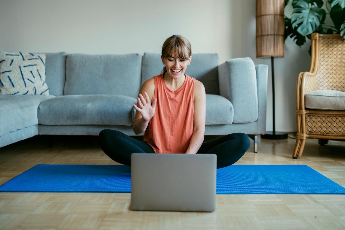 Woman taking an online yoga class during coronavirus quarantine