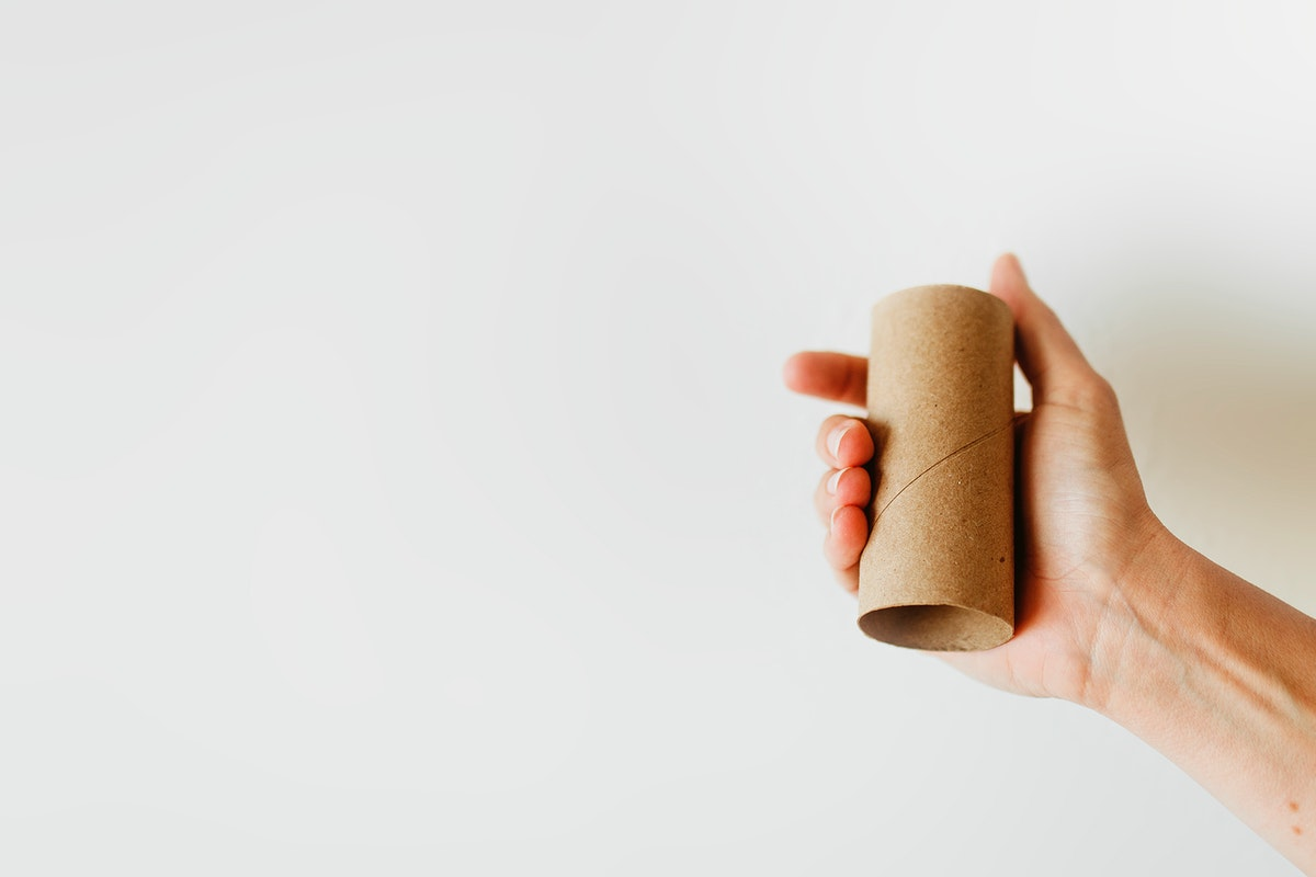 Woman holding an empty toilet paper roll during coronavirus pandemic