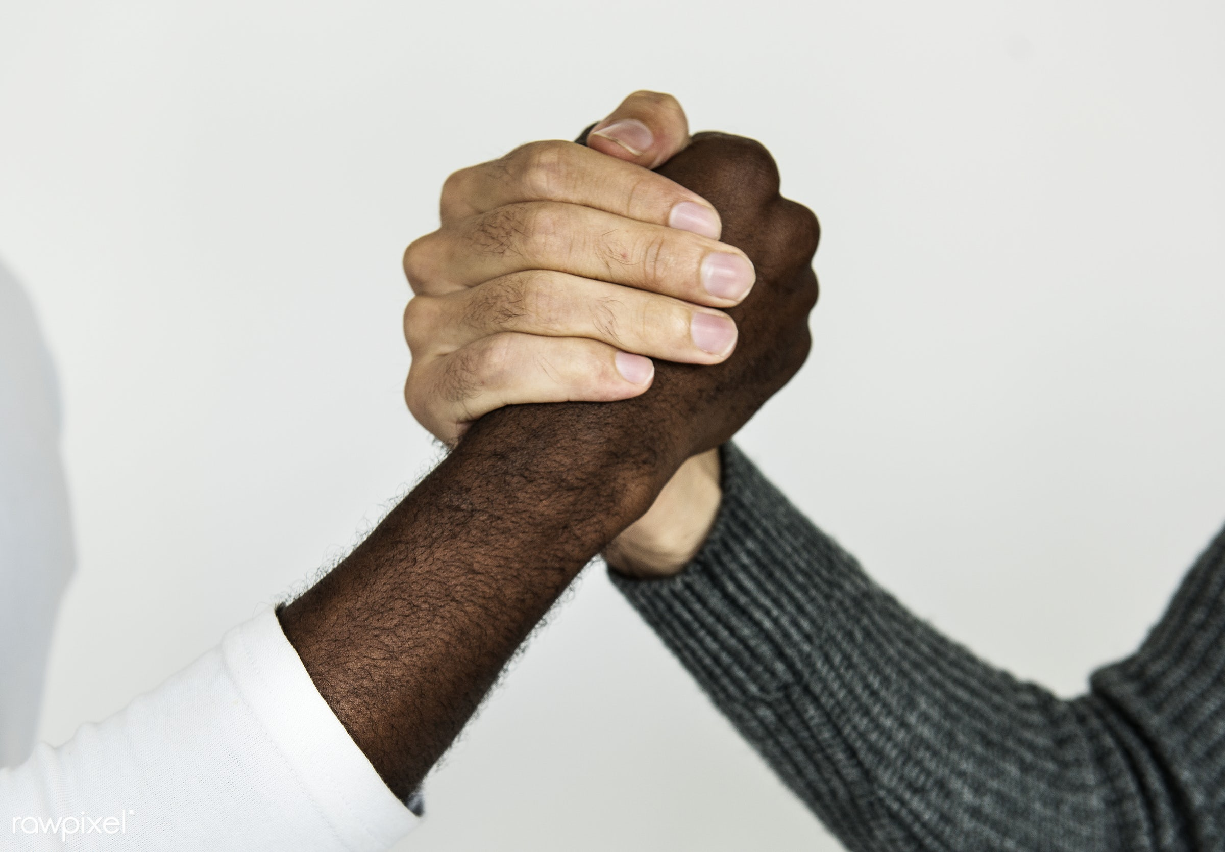 Closeup of diverse hands holding each other - adult, alone, asian, closeup, collaborate, collaboration, encourage,...