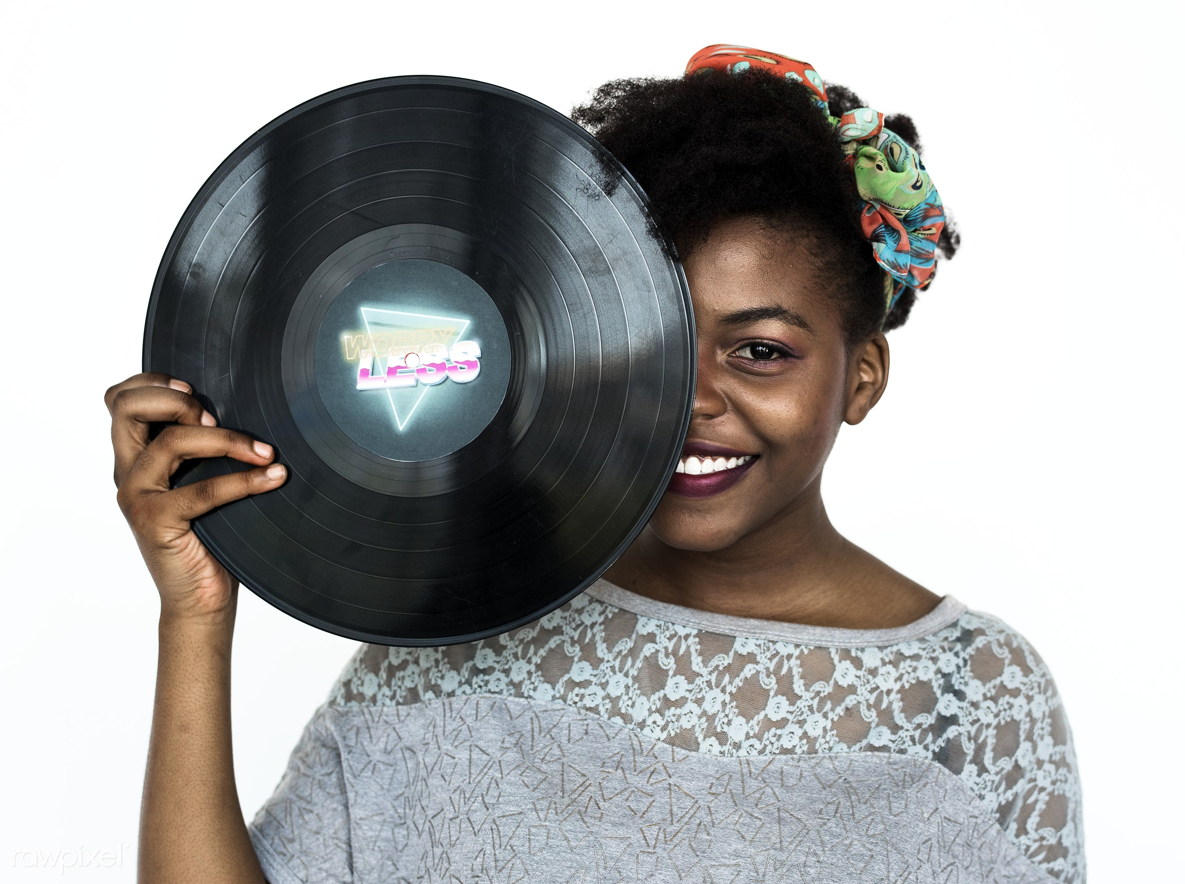 Portrait of an African woman holding a Phonograph record - music, vintage, adult, african, alone, black, casual, cheerful,...