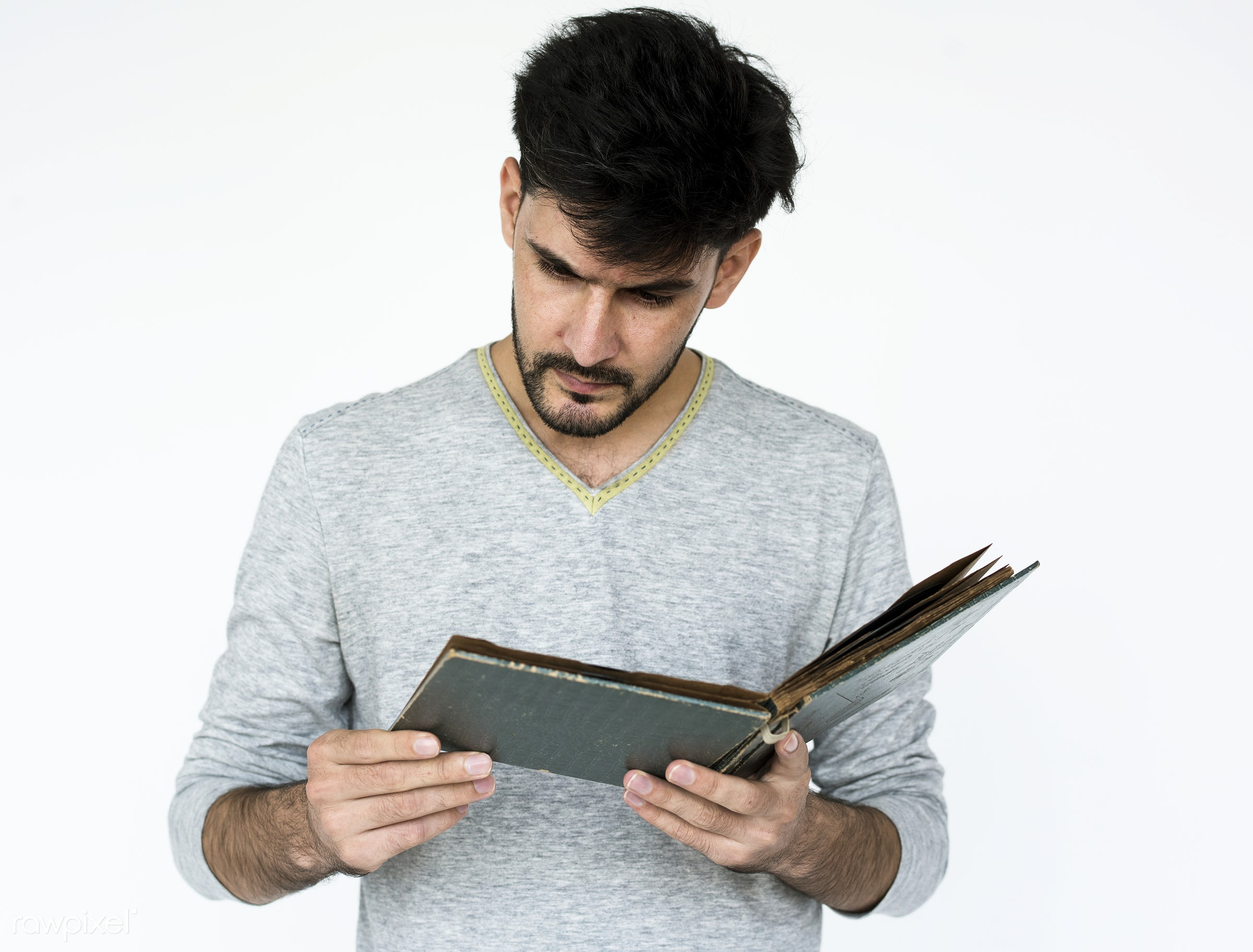 Portrait of a man reading a book - adult, afghan, afghanistan, alone, asian, beard, closeup, expression, face, faces, focus...