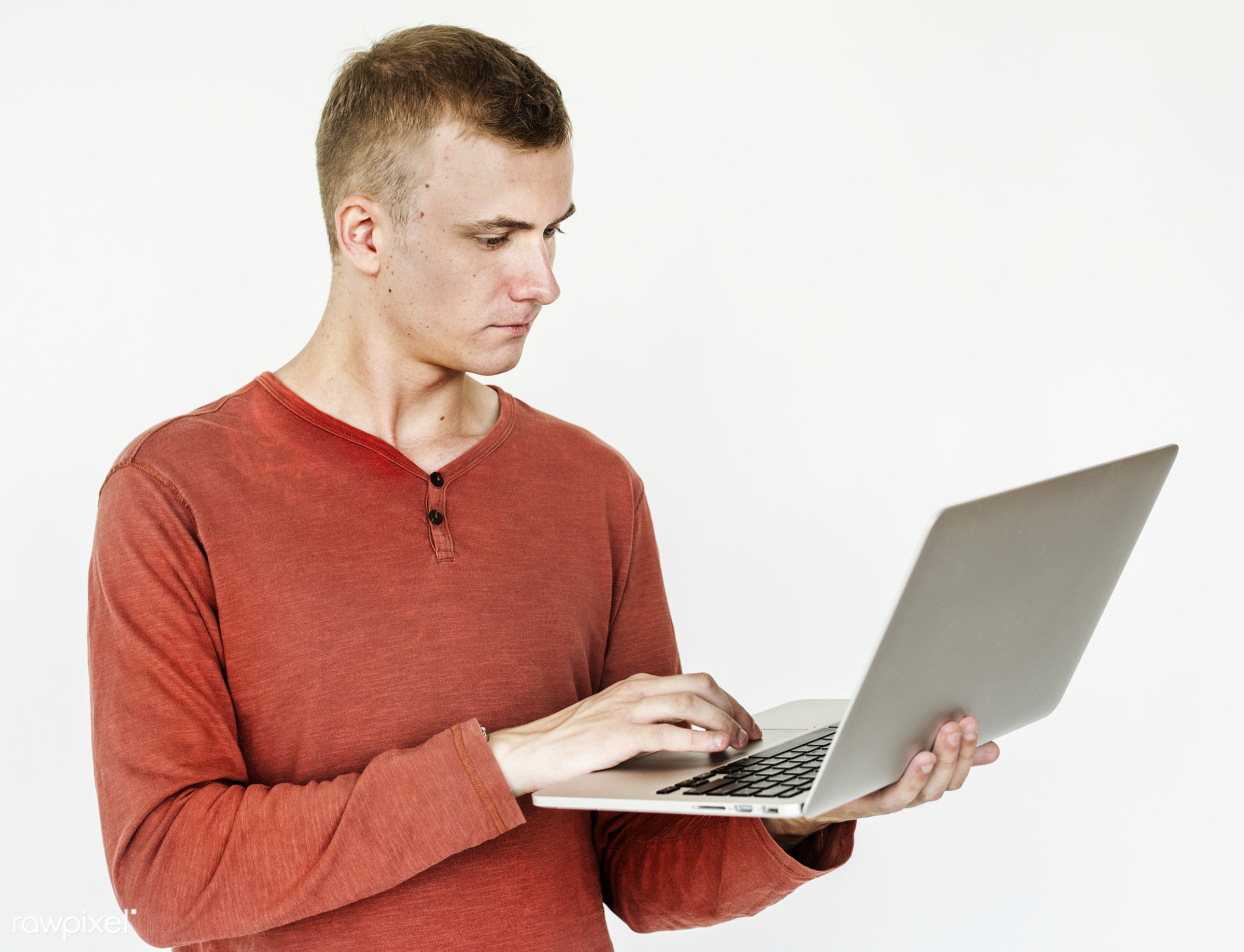 Portrait of a man using a laptop - adult, alone, american, closeup, device, digital device, european, expression, face,...