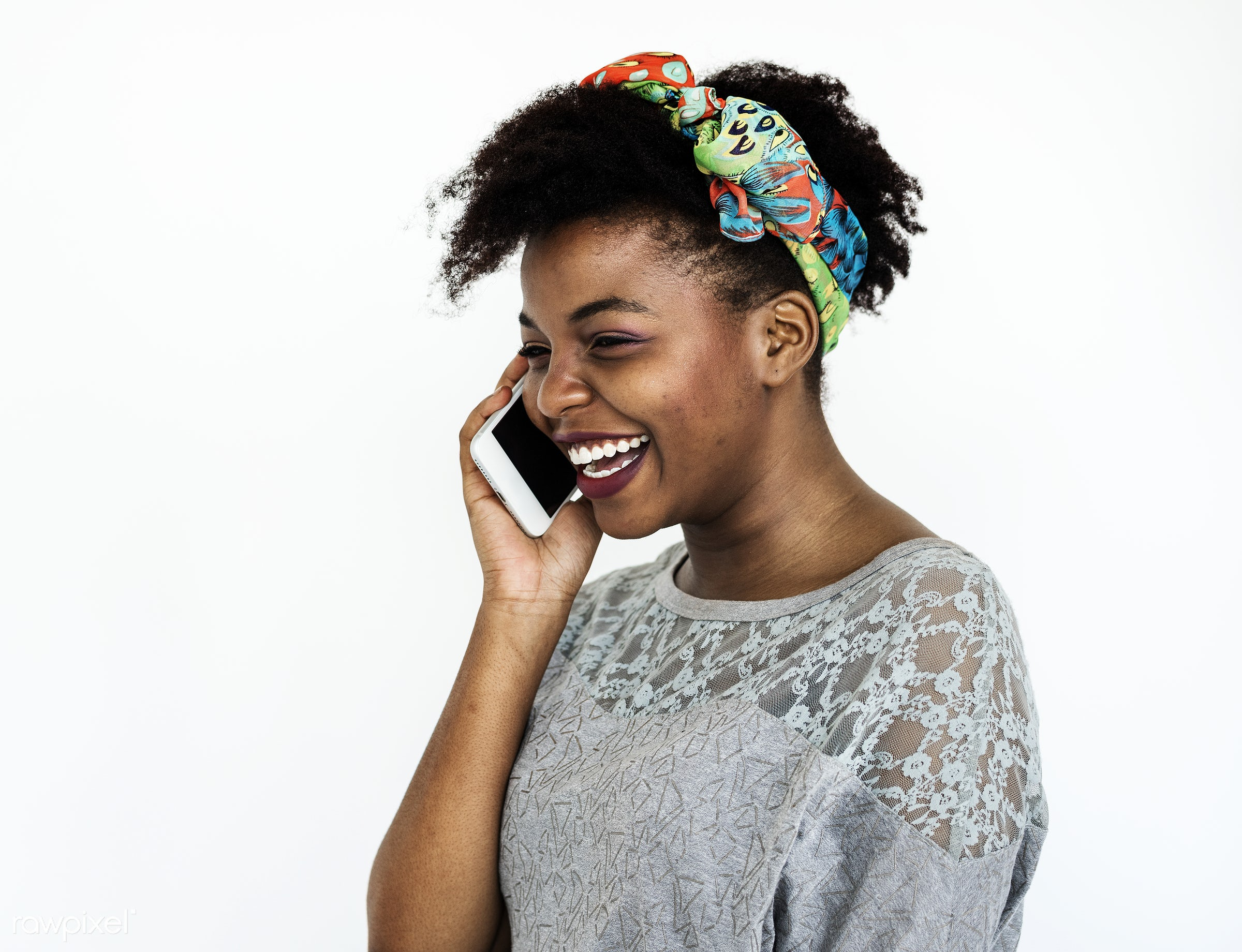 Portrait of an African woman on the phone - mobile phone, african, adult, alone, calling, cheerful, closeup, connected,...