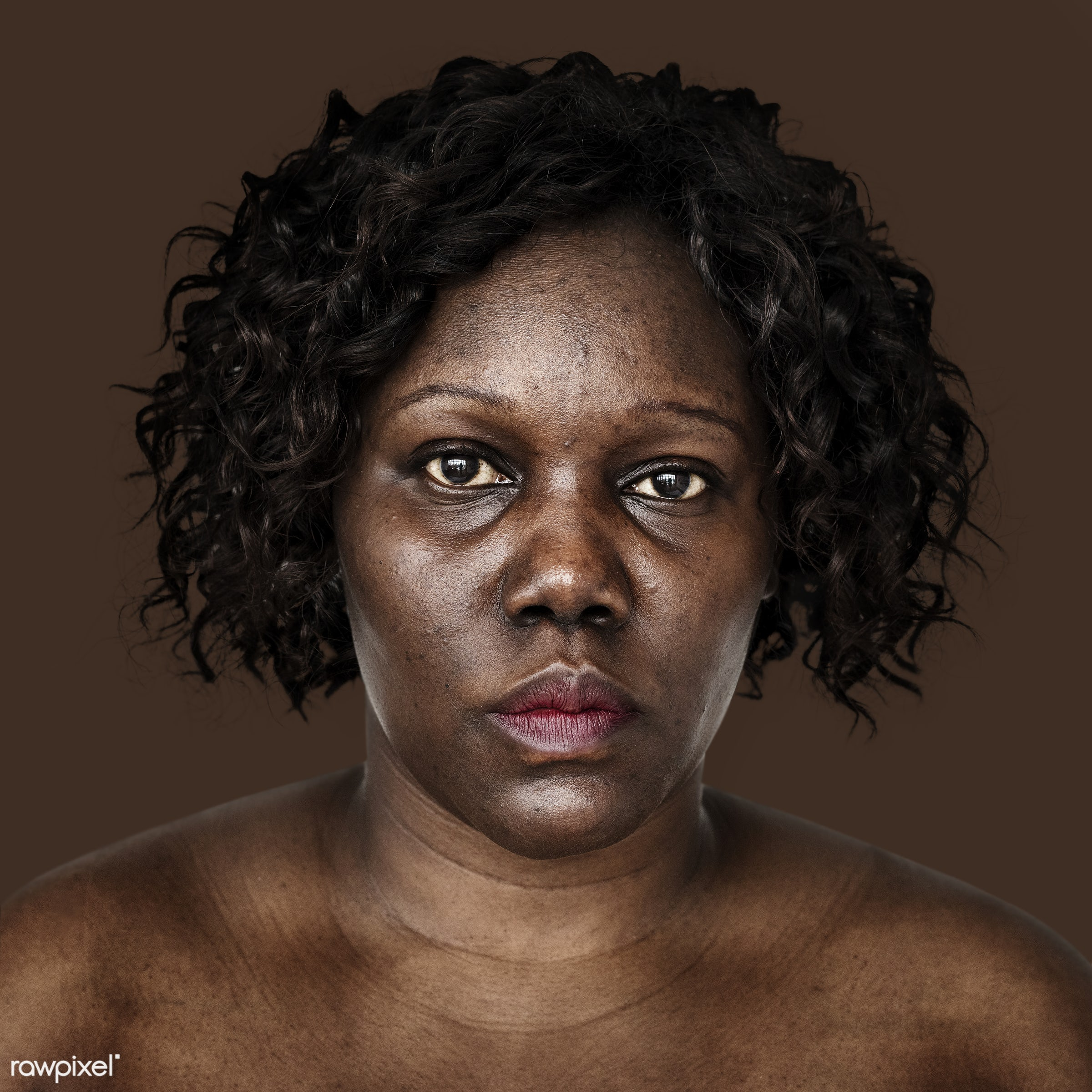 Portrait of an Ugandan woman - adult, african, african descent, alone, bared chest, black, cheerful, east africa, emotion,...