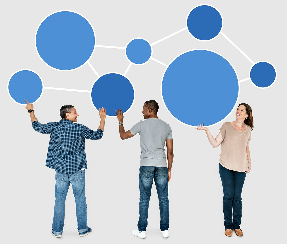 Diverse people holding blue round icons