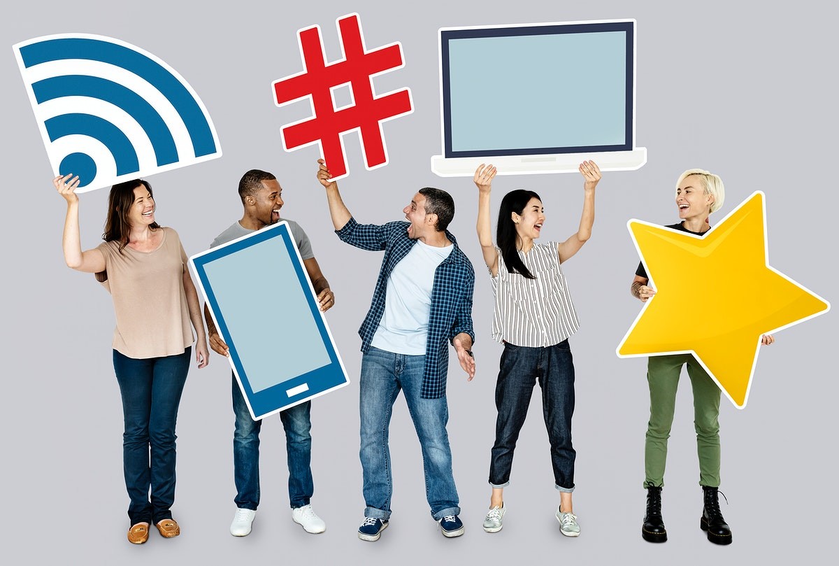 Group of diverse people holding technological icons