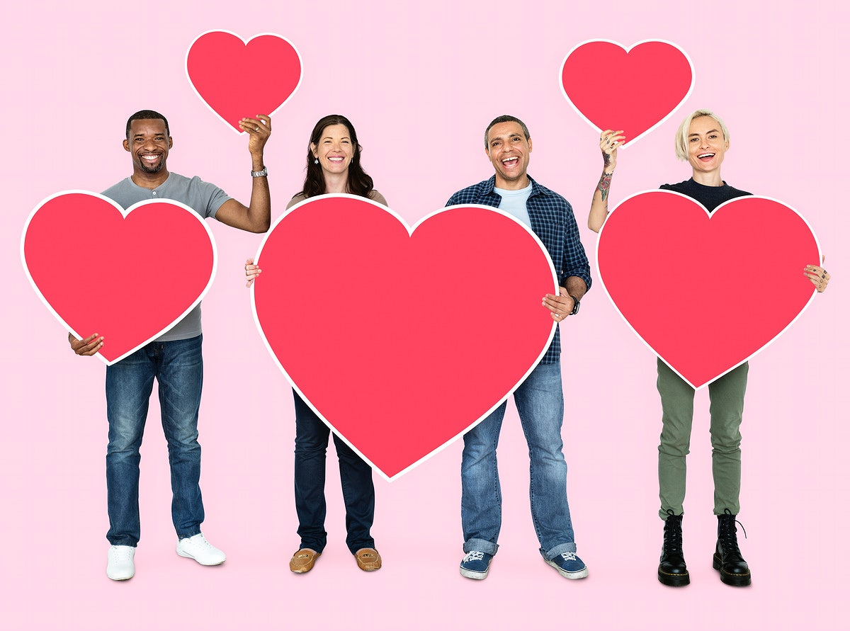 Happy diverse people holding hearts
