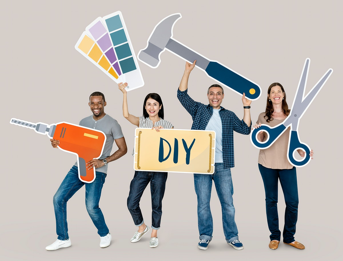 Cheerful diverse people holding DIY icons