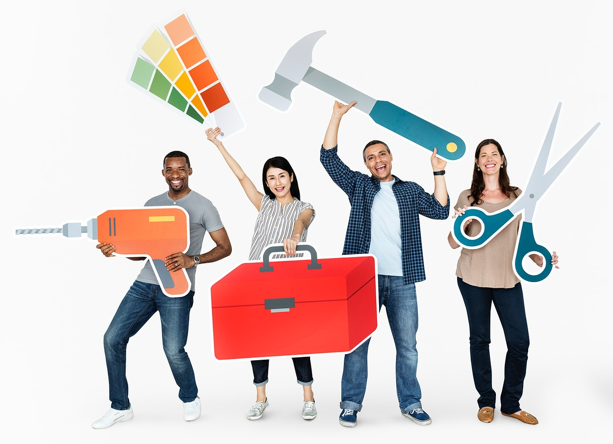 Cheerful diverse people holding tools