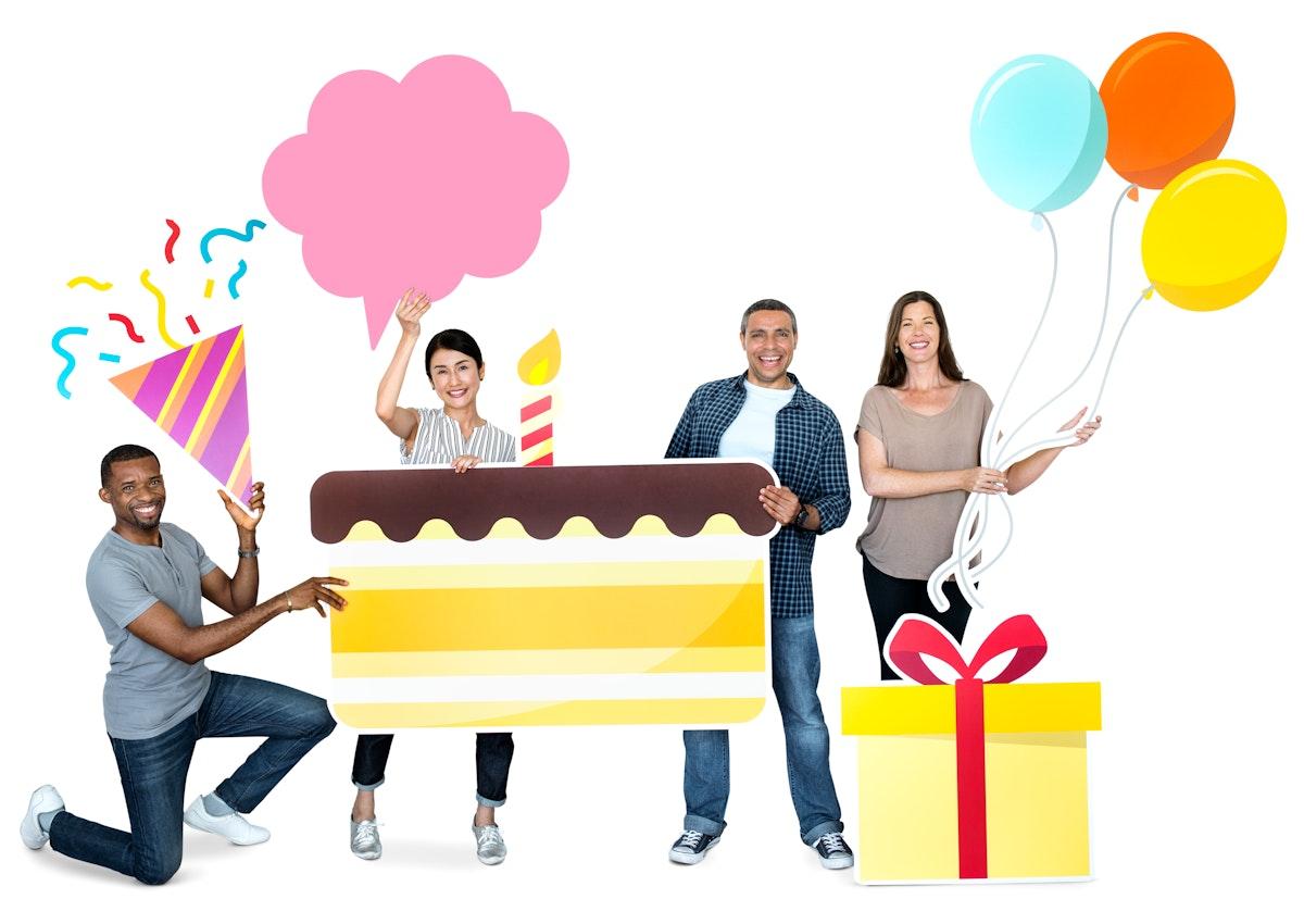 Happy diverse people holding birthday cake