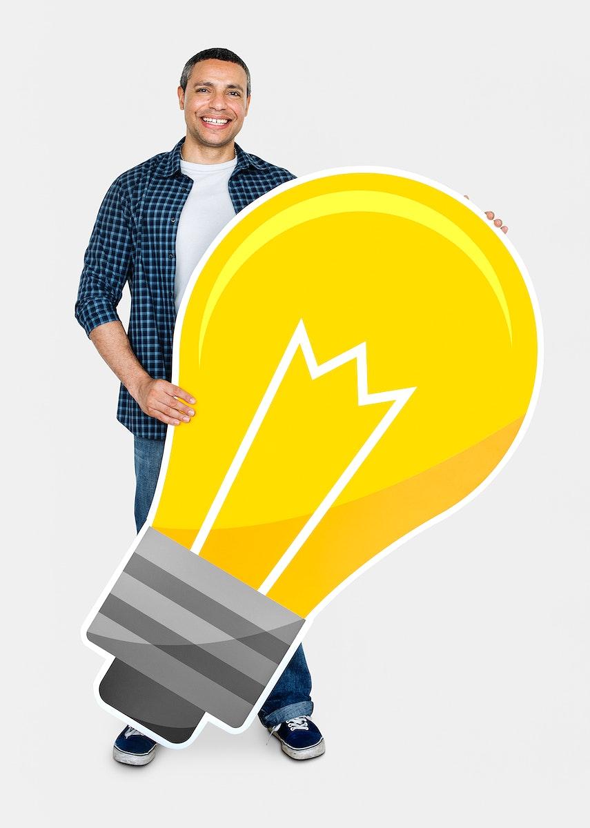 Happy man holding a light bulb icon