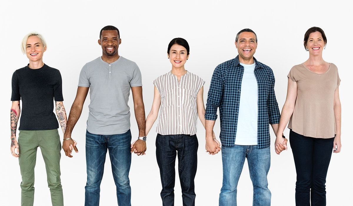 Happy diverse people holding hands together
