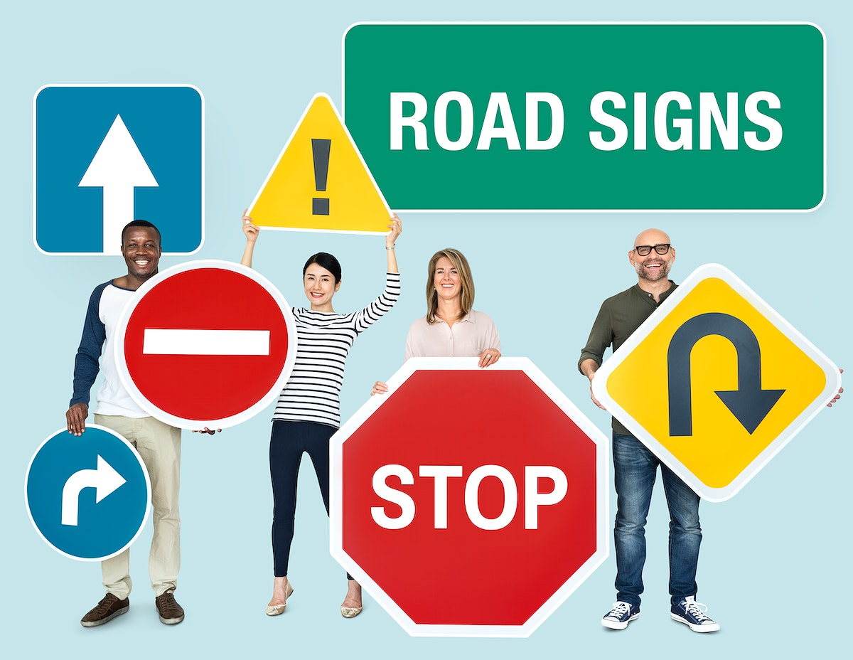 Happy diverse people holding road signs