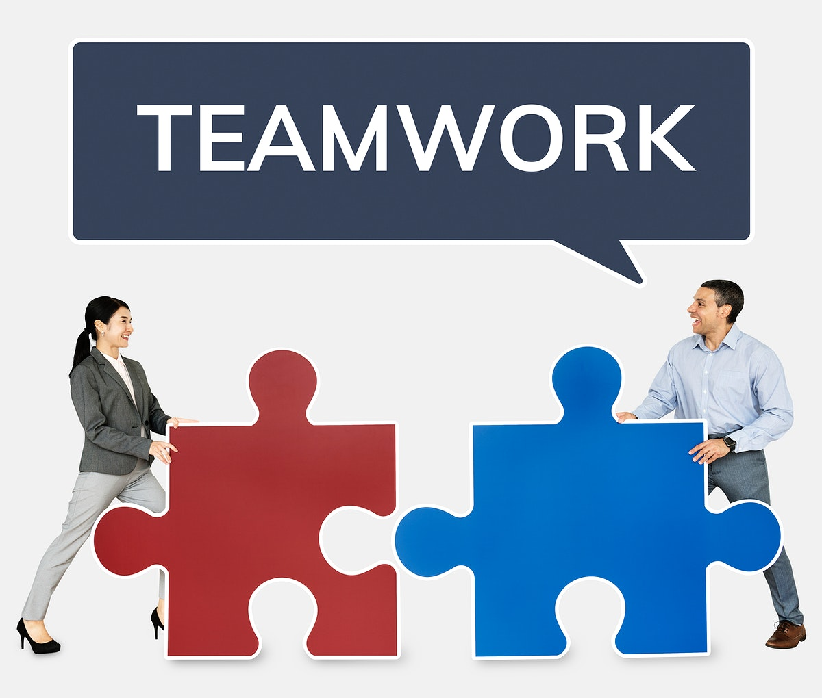 Business people connecting jigsaw puzzle pieces