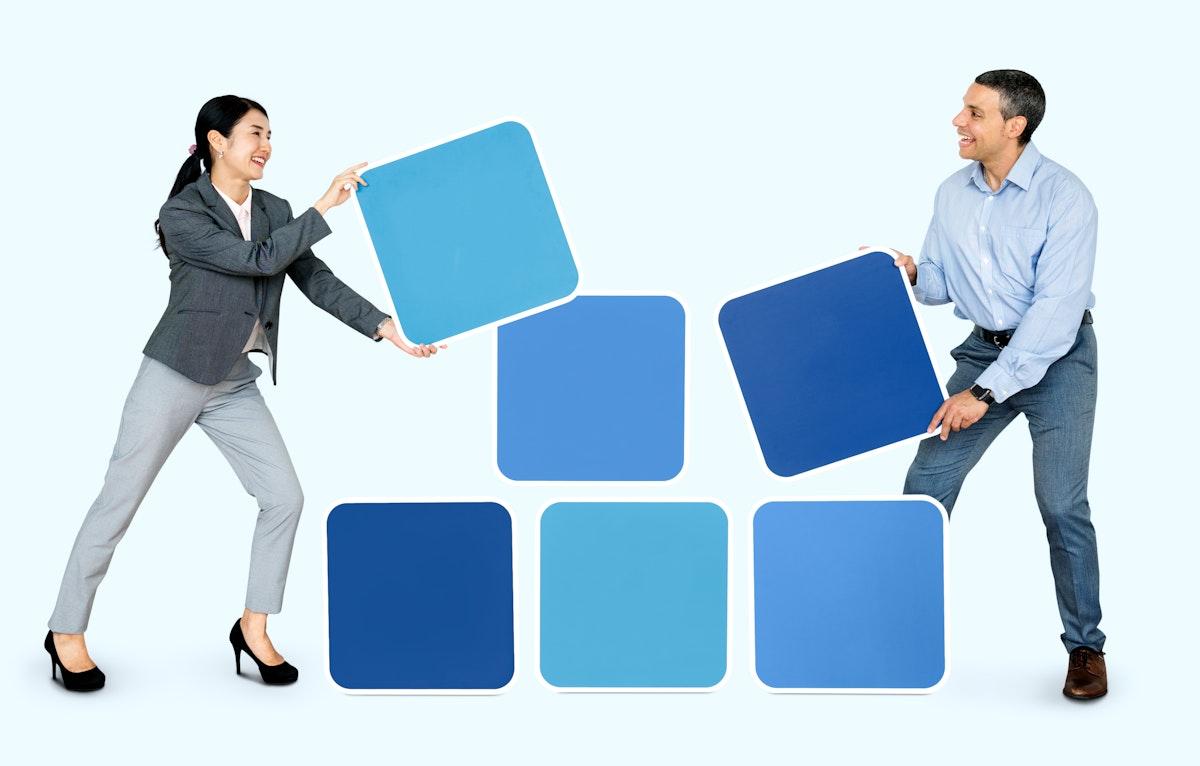 Happy people holding blue blocks