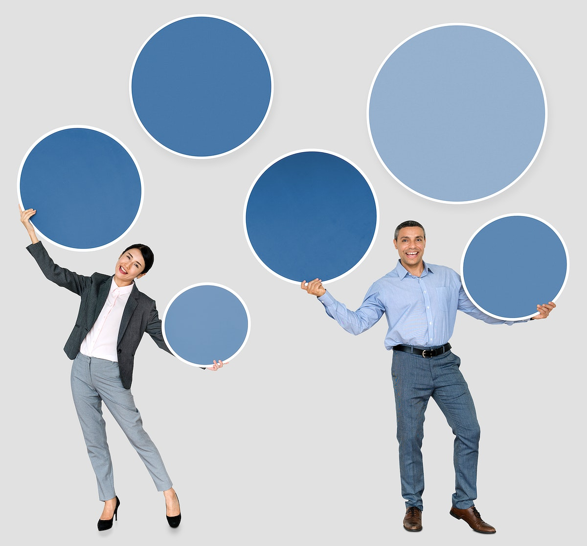 Business partners holding blank circles