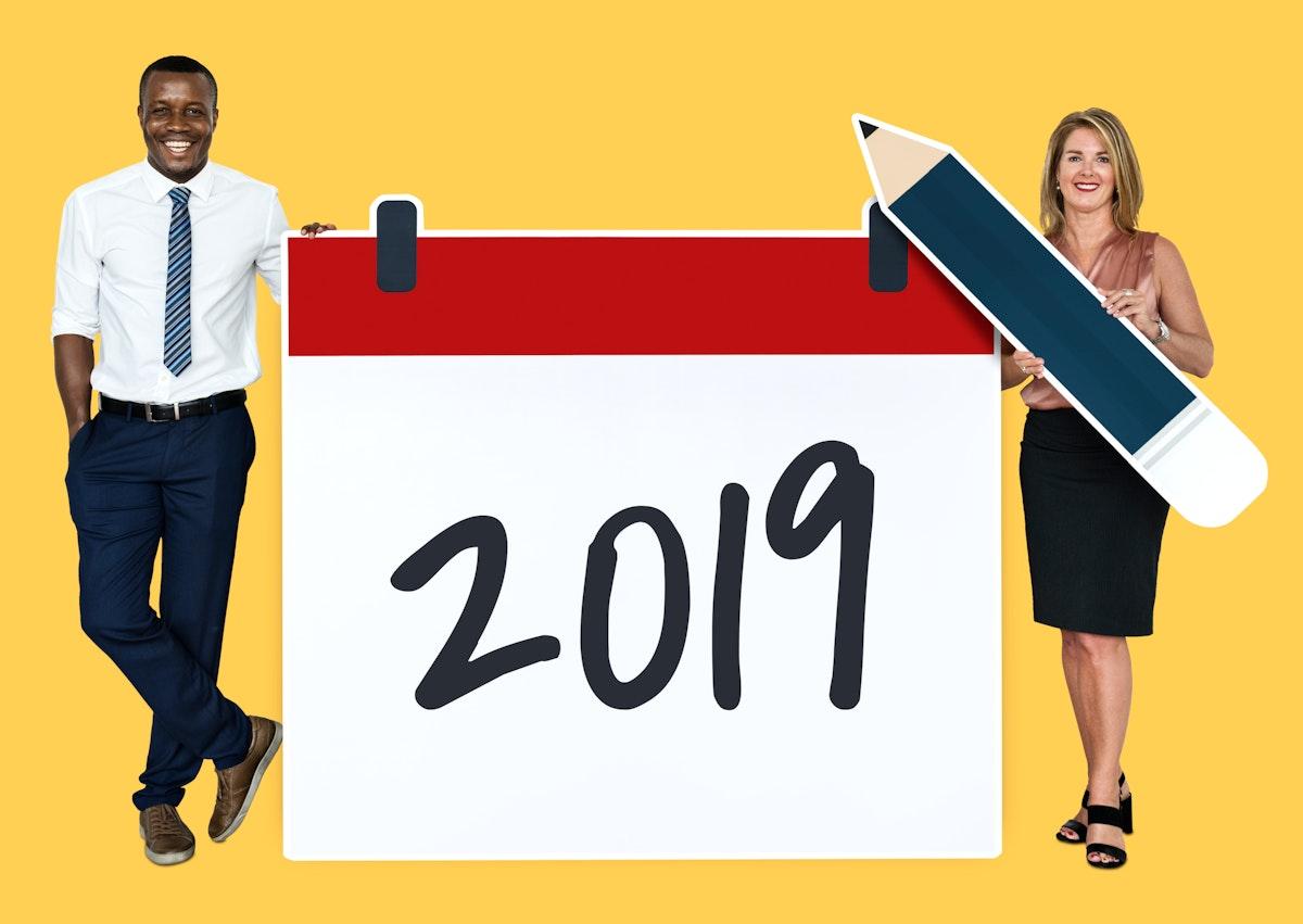 Diverse people holding 2019 calendar